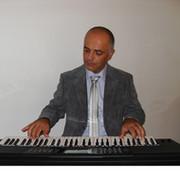 Давид Гасиа(композитор on My World.